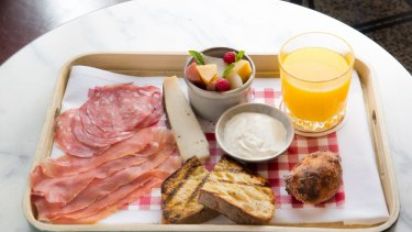 The Venetian B&B, a breakfast tray of cured meats, cheese, fruits and a custard-stuffed donut.