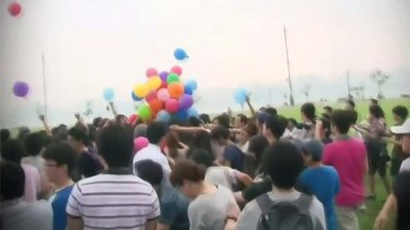 Scrum: 20 people were reportedly injured in the fight over the balloons.