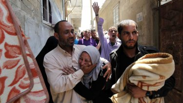 Relatives mourn Haitham Mishal during his funeral in the Shati Refugee Camp in Gaza City on Tuesday.