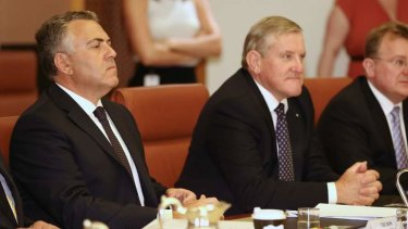 Treasurer Joe Hockey and Industry Minister Ian Macfarlane in a cabinet meeting on Thursday. The two are at odds over industry assistance to SPC.