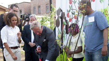 Prince Charles plants a tree at the Common Good City Farm.