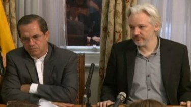 Julian Assange (right) speaks at a press conference with Ricardo Patino, Ecuador's Foreign Minister, in the Ecuadorian embassy in London on Monday.