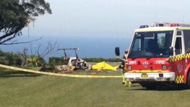 Fire and rescue workers at the scene of a fatal helicopter crash at Bulli Tops.