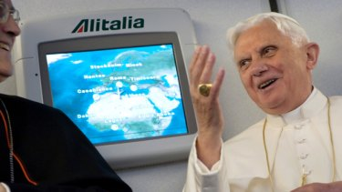 Speaking out ... Pope Benedict XVI gives a press conference during the flight to Yaounde.