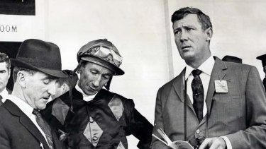 Lloyd Foyster with horse trainer Arthur Ward, far left, and jockey George Moore, centre.