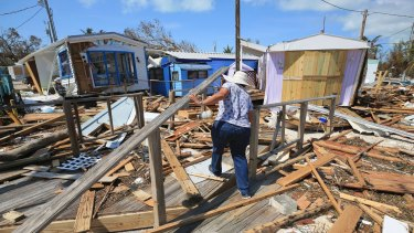 A woman walks through the debris at the Seabreeze trailer park in the Florida Keys on Tuesday, after Hurricane Irma hit the area.