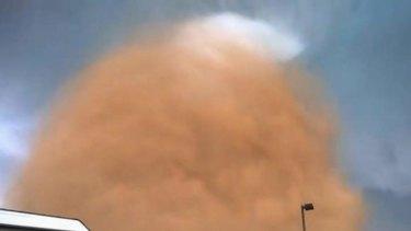 Monstrous swirling mass: The tornado, filmed by by oil worker Dan Yorgason, comes closer.