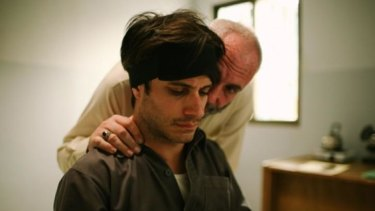 Interrogator Rosewater, played by Kim Bodnia, gets in his captive's ear.