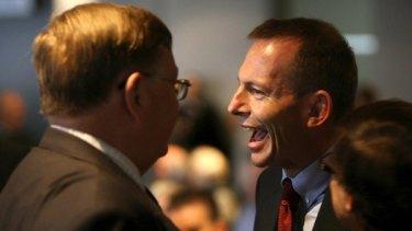 Opposition leader Tony Abbott speaking with Moore Wilton at the Italian National Day Celebrations. <i>Photo Steven Siewert</i>
