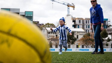 """Charley and her mum Cathy Oke at the """"kick and coffee"""" footy clinic."""