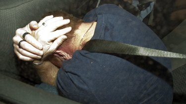 Adrian Bayley hiding from cameras while in police custody after Jill Meagher's murder.