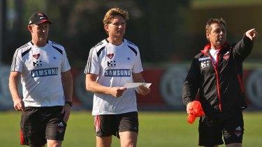 Former Geelong assistant coach, Brendan McCartney, beside Mark Thompson and James Hird at Essendon.