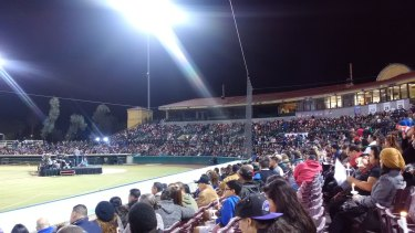 Candlelight vigil for the victims of the shooting in San Bernardino, at San Manuel Stadium.