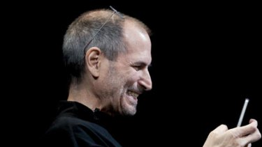 Apple chief executive officer Steve Jobs with an iPhone 4.