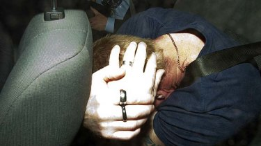 Homicide squad detectives take a 41-year-old Coburg man into custody over the abduction of Jill Meagher in Brunswick.