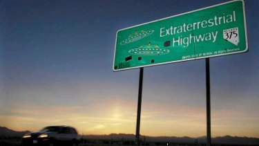 A car moves along the Extraterrestrial Highway in Nevada, USA.