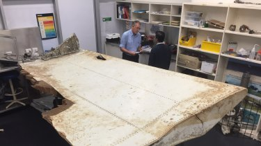 Malaysian and Australian investigators examine the piece of aircraft debris found on Pemba Island off the coast of Tanzania