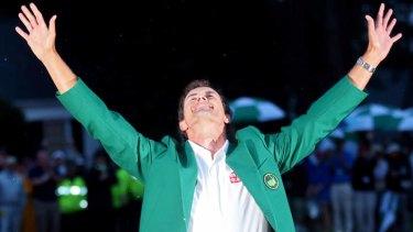 Adam Scott celebrates with his 2013 US Masters green jacket.