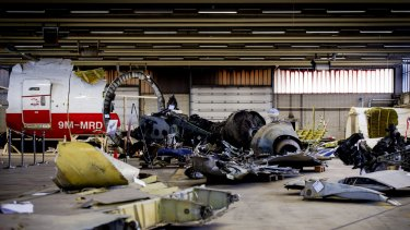 Wreckage from Malaysia Airlines Flight MH17, which was shot down over Ukraine in July 2014, is laid out in a hangar on Gilze-Rijen airbase in the Netherlands.