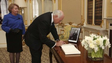 """Courage and resilience"" ... John and Janette Howard sign a book of condolence for Margaret Thatcher at Lancaster House."