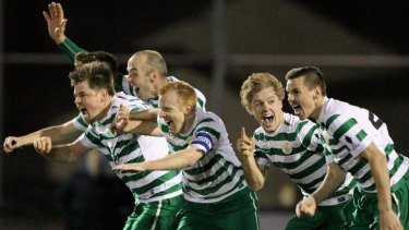Tuggeranong players celebrate their penalty shootout win over South Hobart in the FFA Cup round of 32.