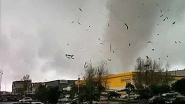 The tornado hits the shopping centre.