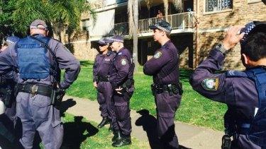Police raid a Wentworthville unit.