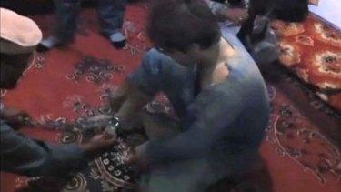Footage believed to be that of Zainullah Naseri under interrogation.