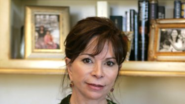 Love and loss ... Isabel Allende cradles a photo of her late daughter, Paula.
