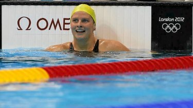 Leisel Jones smiles after finishing second in her women's 100m breaststroke heat today.