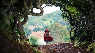 """Dark offerings: Little Red Riding Hood (Lilla Crawford) heads off to see her grandmother in """"Into the Woods""""."""