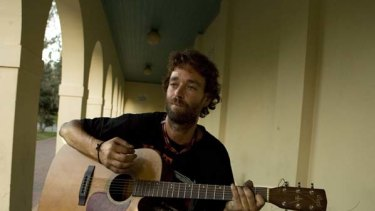 Raymond Humphries plays his guitar.