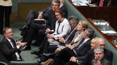 Should I stay or should I go: Julia Gillard looks to supporters on Thursday.