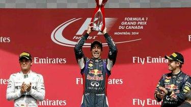 Daniel Ricciardo celebrates with second-placed Nico Rosberg (left), and third-placed Sebastian Vettel (right).