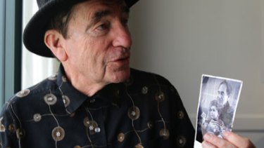 How times change ... Albie Sachs holds a photograph of him with his young son, Oliver.