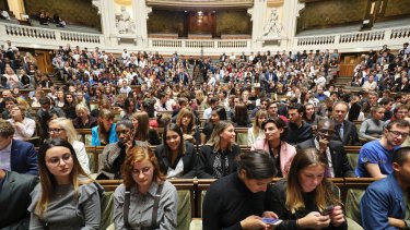 Members of the audience are pictured prior to the start of the French President's speech at the Sorbonne.