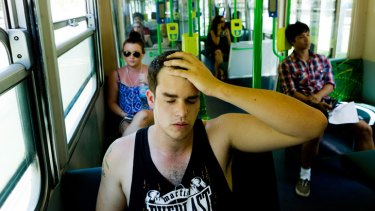 Michael Ferguson sweats on the 67 tram to the city on St Kilda Road.