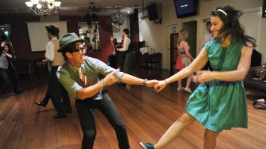 Vested interest: Kieran Yee and Vivi Kalman get into the groove at Fitzroy's Copacabana Restaurant, one of several swing dancing venues around Melbourne.