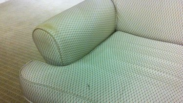 A damaged sofa in the Premier's office.