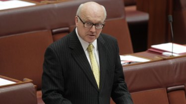 Caught in the middle: Senator George Brandis is wedged between different sectors of the Liberal Party over his promise to dilute section 18C of the Racial Discrimination Act.