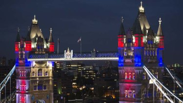 Long to reign over us ... Tower Bridge is bathed in lights for a patriotic lift. Right: Elizabeth II, whose diamond jubilee is Britain's second.