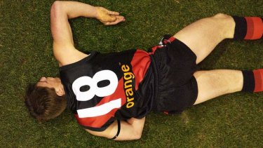 Now-retired Bomber Matthew Llyod lies motionless after being knocked out in a collision with Adam Hunter of the Eagles in 2002.