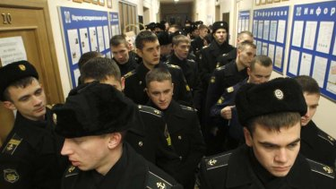 Uniform suspicion ... soldiers queue to vote in Vladivostok as observers question the scale of interference by authorities in the parliamentary elections for the Duma.