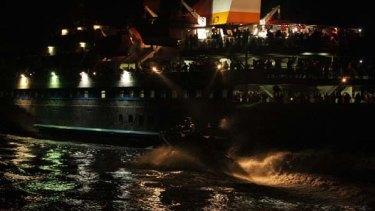 INTERNATIONAL WATERS ...  activists look on as Israeli boats close in on the Mavi Marmara.
