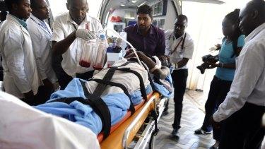Medics help an injured person at Kenyatta national Hospital in Nairobi, Kenya, after being airlifted from Garissa.