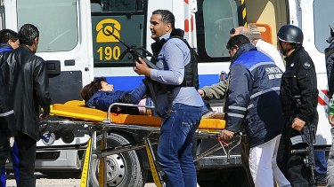 A victim is evacuated outside the Bardo Musum in Tunis.