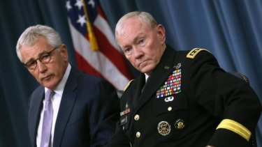 Secretary of Defence Chuck Hagel (left) and Chairman of the Joint Chiefs of Staff General Martin Dempsey speak to the media during a press briefing at the Pentagon.
