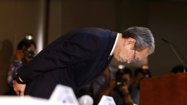 Toshiba President Satoshi Tsunakawa bows after announcing its US nuclear unit Westinghouse had filed for bankruptcy protection.