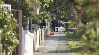 Police tape off Owen Street after the shooting.