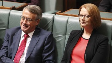 Political victory for Labor: Wayne Swan and Julia Gillard listen to Tony Abbott agreeing to honour tax cuts.